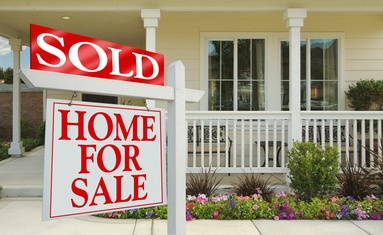 Sign Home for Sale with a sold sign in front of a house