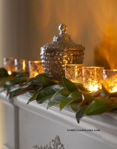candle glowing among magnolia leaf