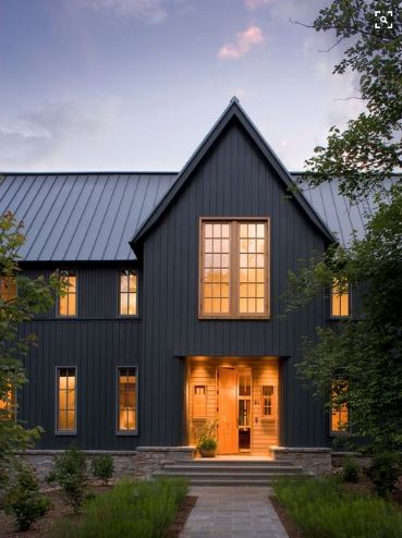 Dark house colors relate well with the roof of this house