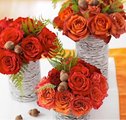 orange roses and birch bark vases