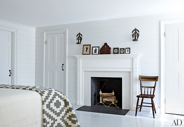 white bedroom with fireplace
