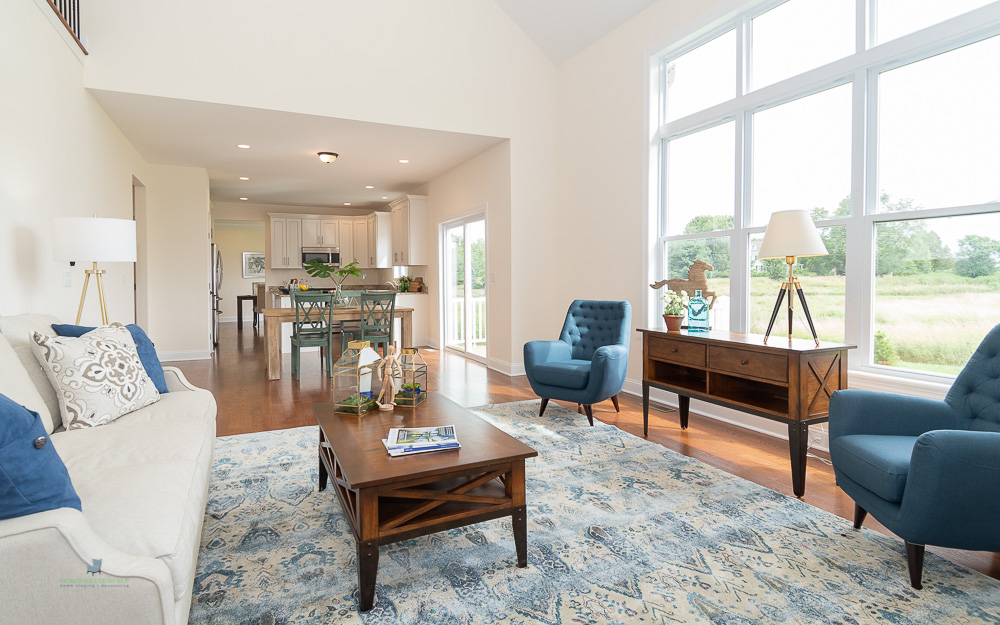 staged living room opened to an eat in kitchen